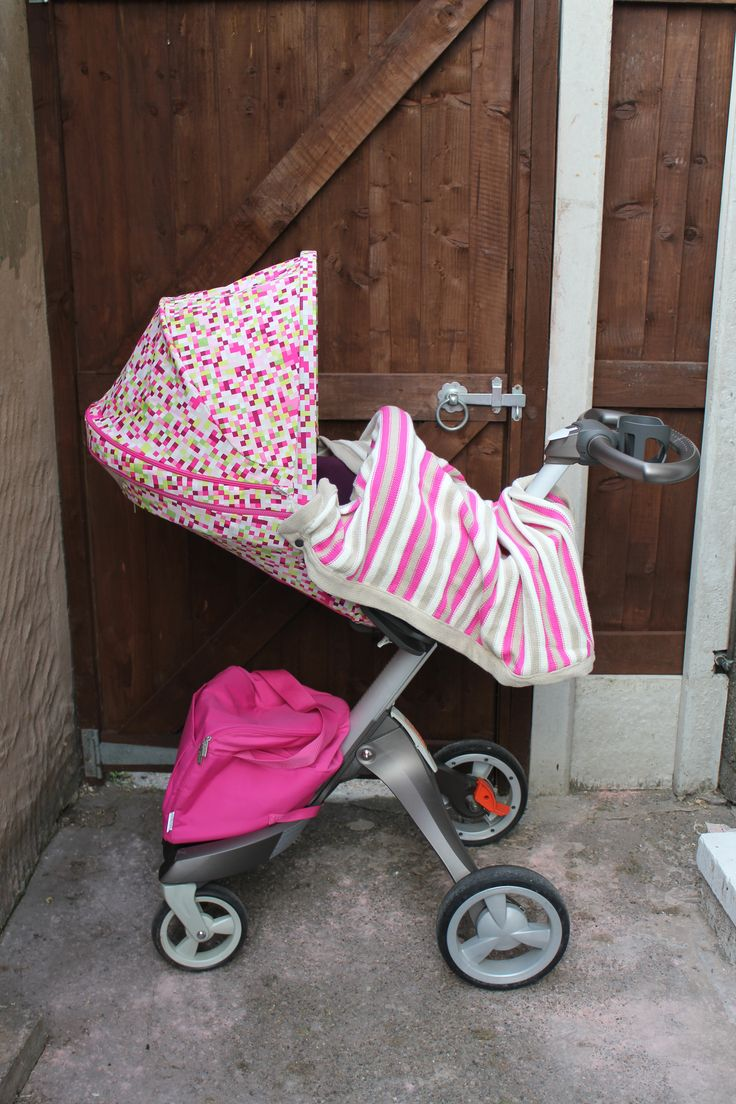 Pink pixels summer kit on the Stokke Xplory with Purple style kit(textiles) pink shopping bag and home knitted blanket.