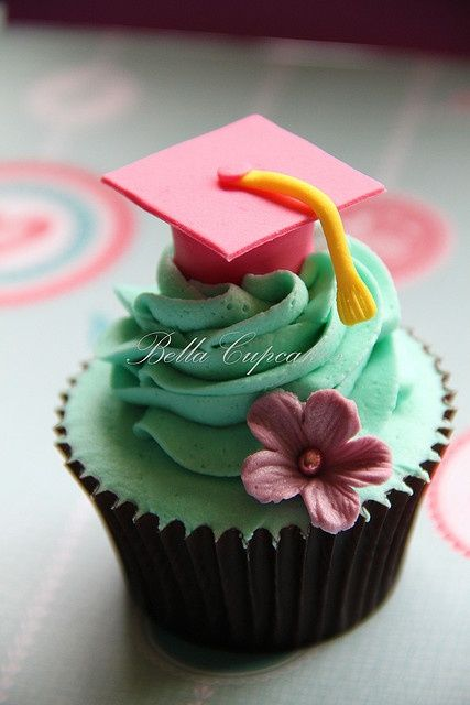 Graduation Day    Graduation cupcakes for a yound lady!! What a great achievement!!    She is a real girly girl so we went for a pink graduation cap instead of the more traditional black cap. #Recipes