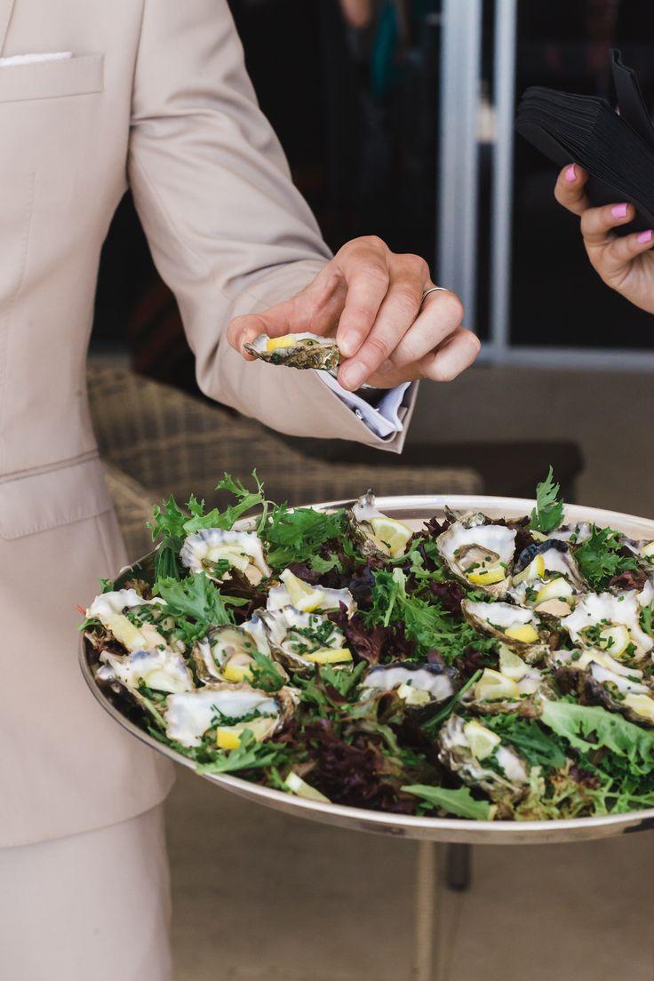 Freshly shucked rock oysters served on rock salt with lemon (gf)