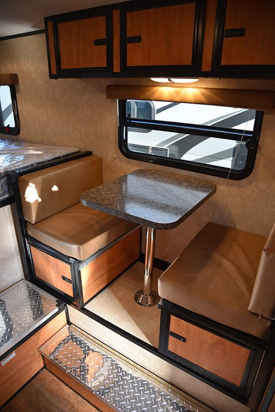 Here is a CampLite 8.6 review.  This is a hard side, non-slide, wet bath truck camper designed for long bed trucks.  Is that a face-to-face dinette?