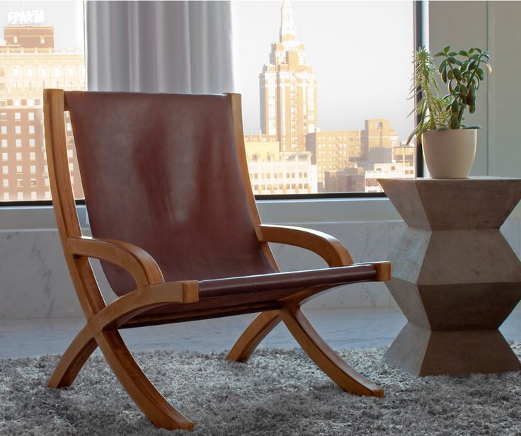 Image result for leather and wood sling chair