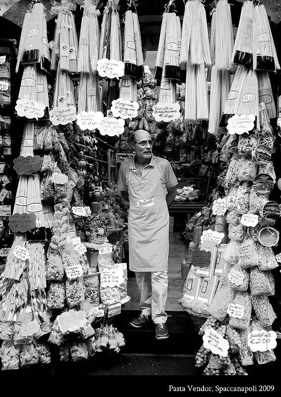 """.As you can see, he specialises in selling pasta. This characteristic little shop can be found in Spaccanapoli, the historic part of Naples. The name """"Spaccanapoli"""" literally means """"Naples Splitter"""" and was one of the first three streets of the original Greek city Neapolis (New City)."""