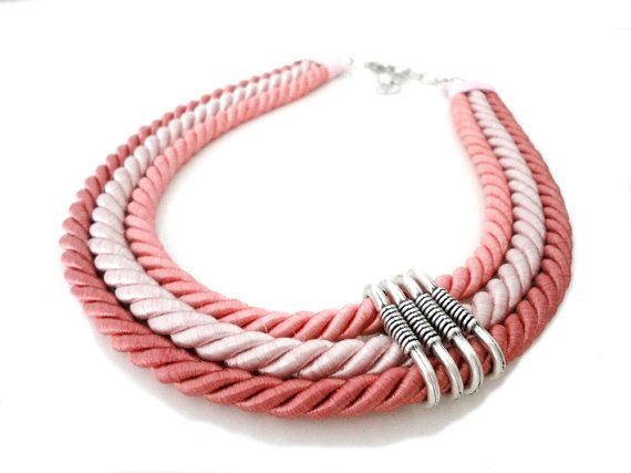 This multi strand statement necklace features 3 strands of twist cords in peach, pink and dusty rose colors which were all gathered on the side with