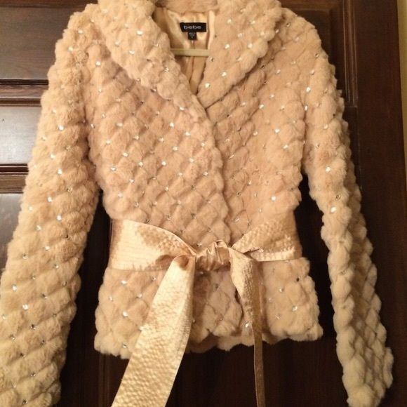 HPRare Ltd Bebe Rabbit Fur/Crystal Jacket Brand new without tags. This cream rabbit fur jacket is beautifully embossed with a diamond shaped pattern and embellished with oval clear crystal stones. Comes with matching satin sash belt which is kept in place with two belt loops. There are also two lined front pockets. The collar can be worn up or down. This is the most luxurious, show-stopping limitrf jacket that Bebe had ever produced. It is in never worn pristine condition. Bebe Jackets…