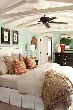 Light aqua walls, black and white furniture, taupe bedding- this would look great in one of our cottages!