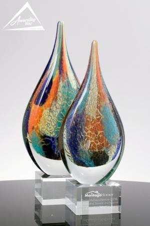 The Prism Multi Color Art Glass Award is a stunning art glass award that's sure to thrill the recipient.  They are great when you want to add a colorful and unique award to your program.  The Prism Art Glass Award is available in two sizes: 11 inches tall and 12 inches tall.  The solid black crystal base can be engraved with your personalized text.