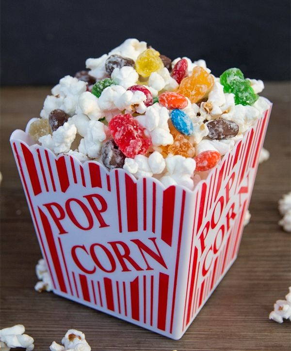 Movie Theater Candy Popcorn  2 bags Orville Reddenbacher's Simply Salty Microwave Popcorn (or any other non-butter popcorn) 2 cups white chocolate chips, melted 1 bag gummy bears * 1 movie theater box size MnM's * 1 movie theater box size Raisinettes *  *substitute your favorite candy  1. Pop the popcorn and pour onto a large cookie shee