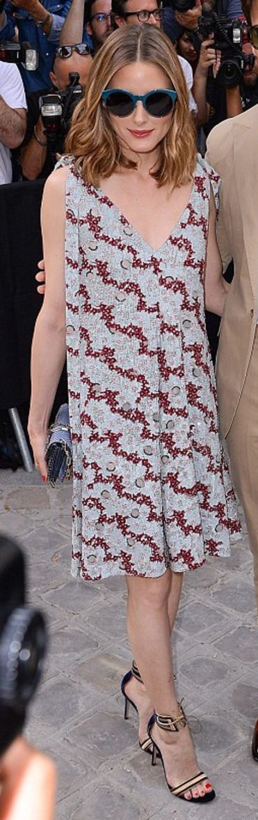 Who made  Olivia Palermo's red print dress, blue handbag, gold tie sandals, and sunglasses?