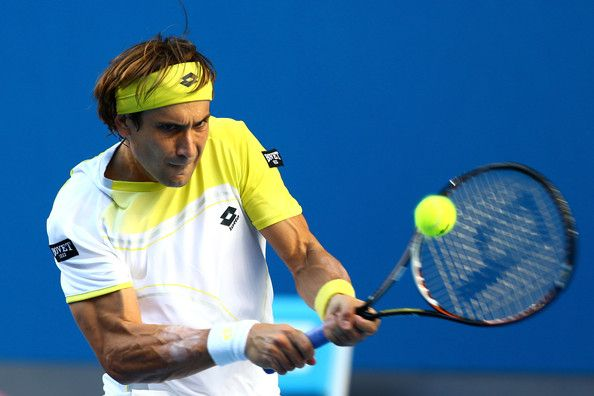 David Ferrer of Spain plays a backhand in his first round match against Olivier Rochus of Belgium during day one of the 2013 Australian Open at Melbourne Park on January 14, 2013 in Melbourne, Australia.