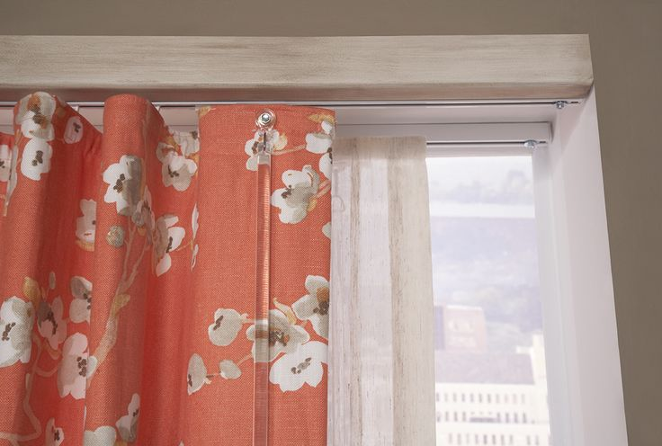 A routed baton-draw pole from Finestra Decorative Hardware is the ideal topper for the Ripplefold panels. I Rowley Company