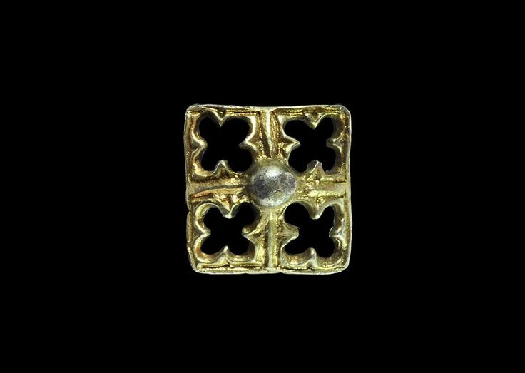 14th-15th century AD. A small square silver-gilt mount, slightly domed, with central knop and quatrefoil void to each quadrant. 1.63 grams, 15mm (