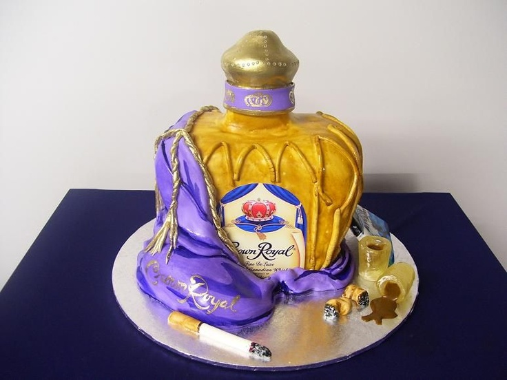 Crown Royal Bottle - This is all cake that was hand carved, covered in fondant and painted with brown food coloring mixed with actual crown royal whiskey.  The shot glasses are sugar and the bag is fondant.