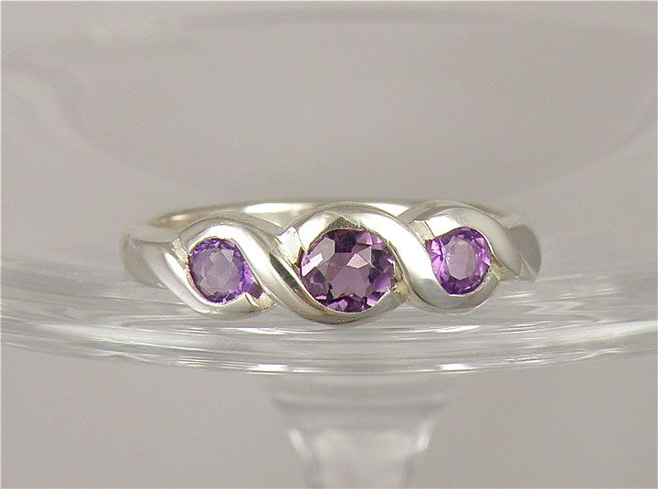 This Ring is beautiful and Solid with 3 Lovely hand-set stones. You can have this ring in gold as well with whatever gemstones you wish...Ruby, Garnet, Sapphire, Emerald, Topaz, Peridot, Citrine....and on and on. We can make it.