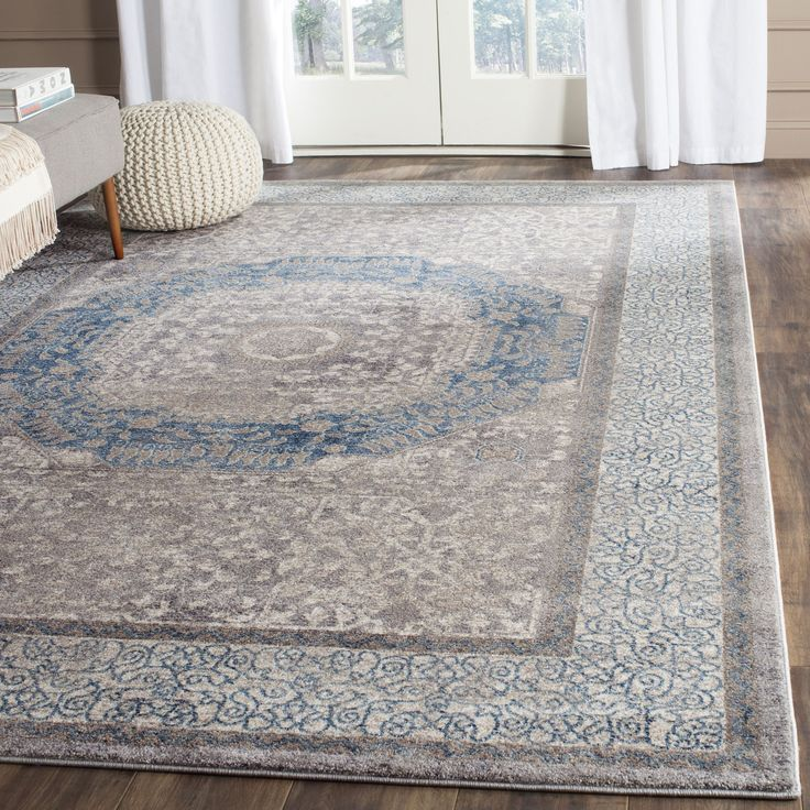 """Features: -Sofia collection. -Material: Polypropylene. -Power-loomed. -Pile Height: 0.35"""". -Made in Turkey. Product Type: -Area Rug. Primary Color: -Gray and blue. Border: -Yes. Border Color:"""