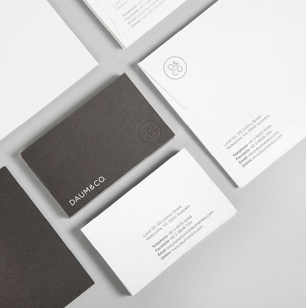 Daum & Co business card with blind emboss detail designed by Hunt Studio.