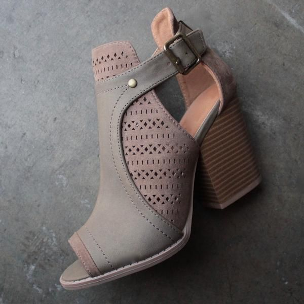 Peep toe booties featuring a perforated design, side buckle closure, and finished on a stacked chunky heel. Material: Man-made, leatherette Sole: Synthetic Meas