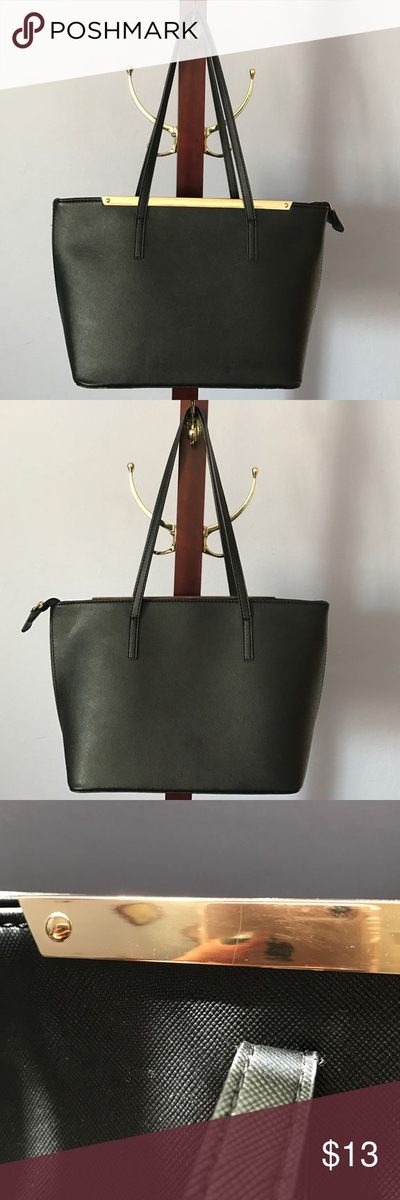 Black hard material Aldo tote bag Stylish black tote bag, length 9 inches, handle straps 10 inches, width 14 1/2 one flaw the gold rim on top had a small scratch. Bags