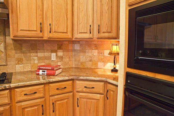 granite with oak. http://tolucagranite.net/client-showcase/crema-bordeaux-granite-kitchen-austin-texas/