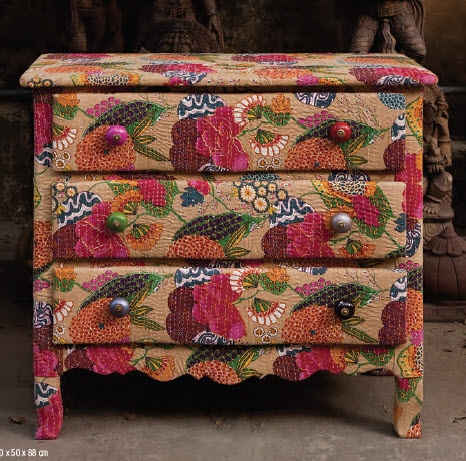 Fabric covered dresser. Never heard of this before, but I'd like to try it!