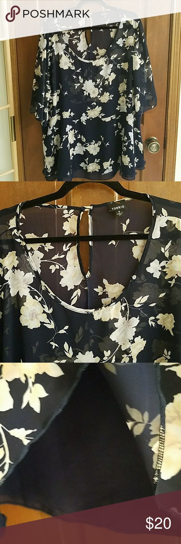 Torrid tunic, navy floral, bottom lined, EUC Navy blue with white, gray and pale peach in flowers. A-line shape. Sheer fabric upper portion with short bell sleeves, keyhole and button in back. Attached lower portion lined, solid lining peaks out at bottom. Torrid size 3 (3X, size chart pic 8). Armpit to armpit approximately 28 inches. Approximately 30 inches long in back. 100% polyester. Color seen best pic 3. Excellent used condition without defects. Torrid Tops Tunics
