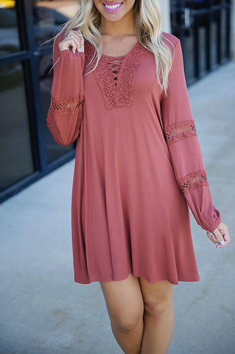 Beautifully boho! This brick colored peasant style dress shines bright in billowy sleeves, a criss-cross front, & crochet inserts for a fashion forward feel!