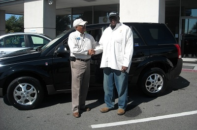 Folger Subaru Sales Consultant Bill Barber with Mr. Fox and his 2004 Saturn Vue SUV!