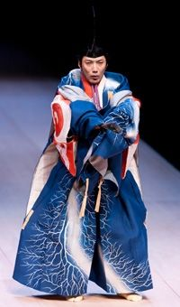 Mansai Nomura on stage.