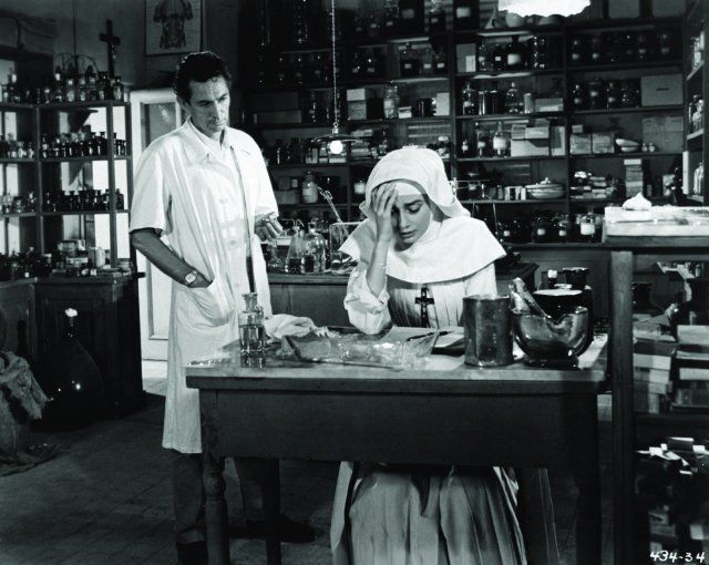 Sister Luke (Audrey Hepburn) confides her greatest fear to Dr. Fortunati (Peter Finch). 'The Nun's Story', 1959.