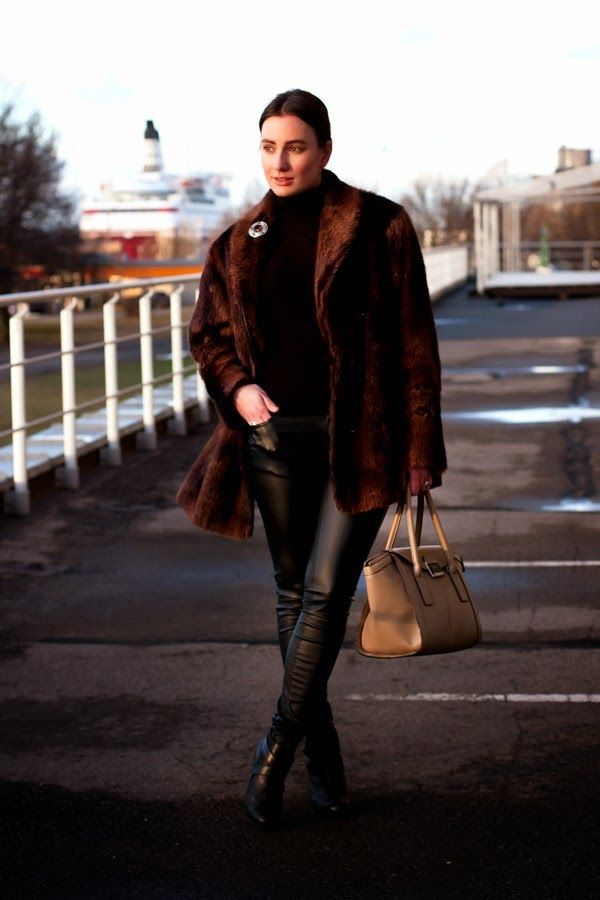 Shop this look on Lookastic:  http://lookastic.com/women/looks/fur-coat-turtleneck-brooch-skinny-pants-satchel-bag-ankle-boots/7459  — Dark Brown Fur Coat  — Black Turtleneck  — Silver Brooch  — Black Leather Skinny Pants  — Tan Leather Satchel Bag  — Black Leather Ankle Boots