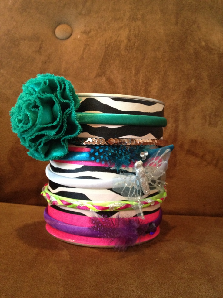 Organize all your hair supplies - adorable headband holder that can hold hair bands inside. Took 1 minute to make. Empty formula can (could be coffee can) covered in designer duct tape! My daughter loves it.
