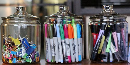 Art and/or office supplies, organized. I just love these jars.
