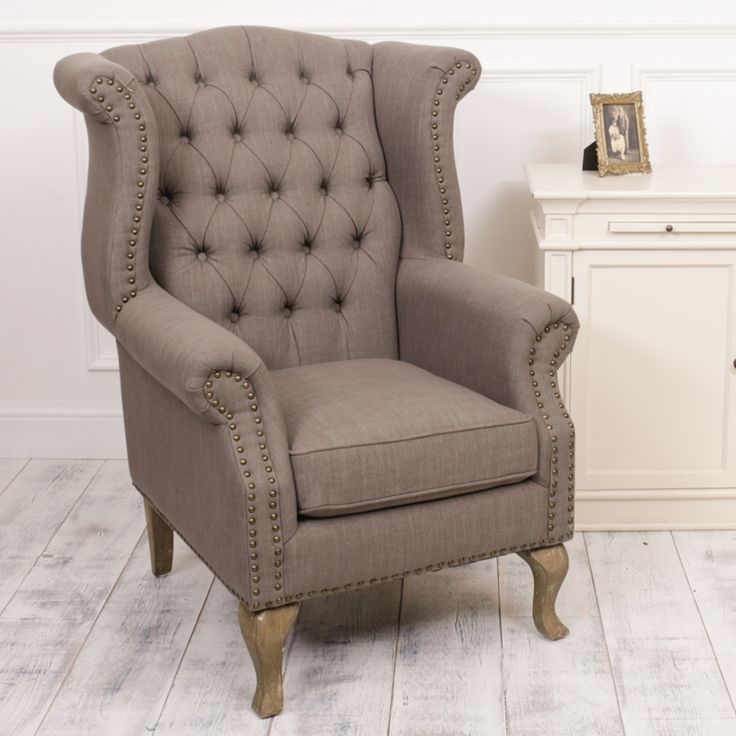 Upholstered in a durable grey linen fabric, the charming armchair features a classic high back for support and added comfort, complete with button detailing and solid wood turned legs, complementing contemporary or country style homes. A timeless piece of furniture adorning any living space, ideal for conservatories or as an accent inside your living room, the perfect addition to any home.