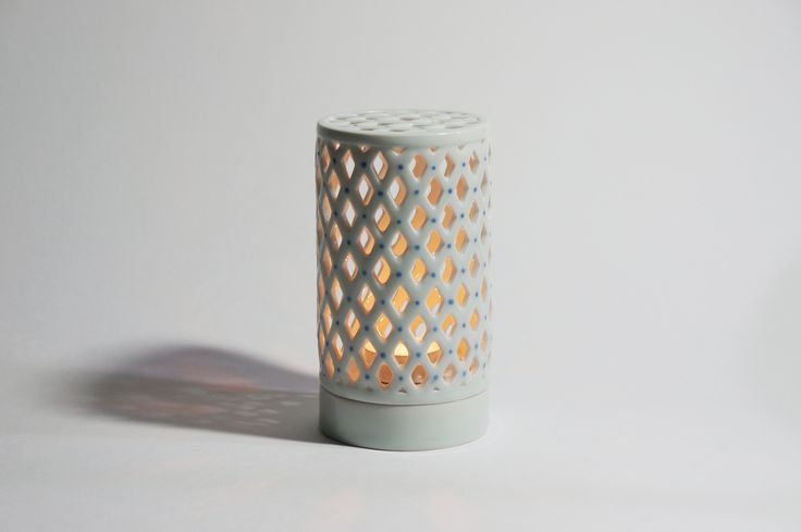 Porcelain Tealight holder / 2016 / Porcelain /Spinning wheel / Openwork to the cylinder / made by Heul-gi