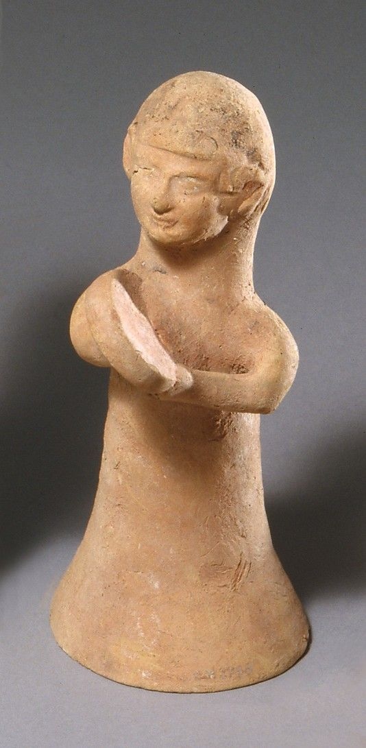 """Terracotta female musician, ca. 600–480 B.C.,  Cypriot; (Terracotta; wheel-made, hand-made, and mold-made); """"Musicians appear frequently among Cypriot limestone and terracotta sculptures. In real life, one of their major functions was to accompany dancers, ritual and secular. One of the figures plays a tambourine, the other probably a triangle."""""""
