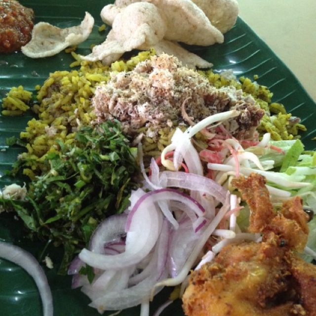 Fragrant rice cooked in many types of herbs and served with finely cut raw parsley, taugeh, flower bud (bunga kantan), long beans, lettuce, fried chicken/fish n very spicy sambal belacan. Best found in Kota Bahru, Kelantan, Malaysia!!