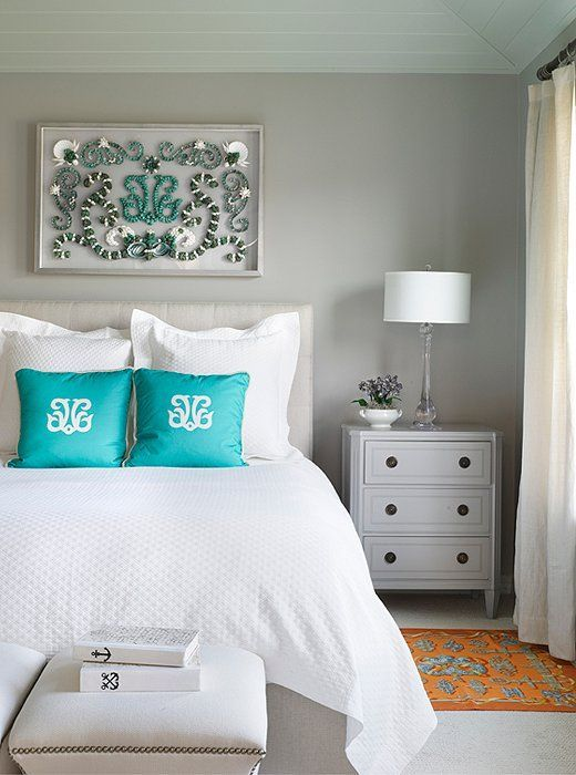 A neutral gray along with cream bases can be punched with turquoise and oranges a make a very attainable statement.
