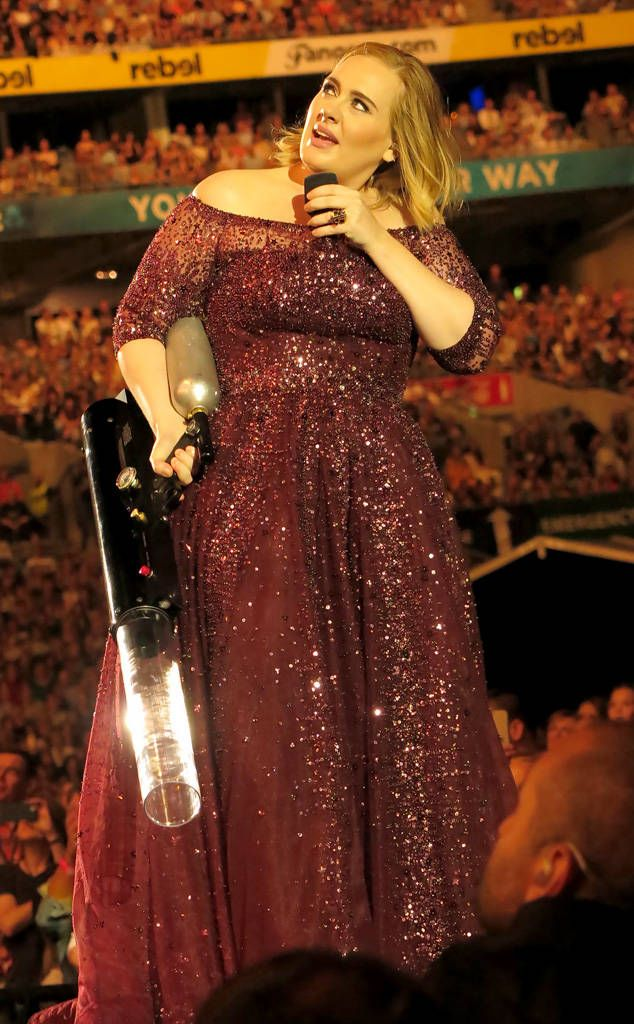 Adele from The Big Picture: Today's Hot Photos T-shrits anyone? The singer  shoots some freebies into the air at her concert in Sydney.