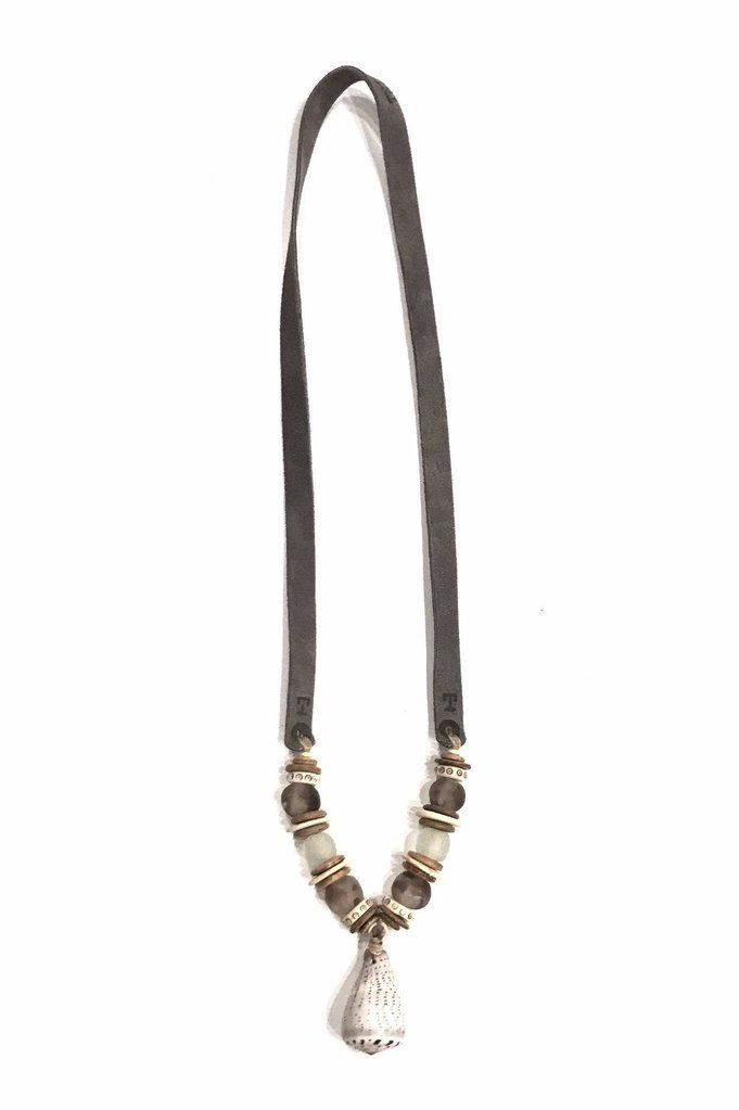 The Twine & Twig Slim Shell is designed with a smaller sized cone shell, globally sourced beads and tied onto a thin branded suede strap. Twine & Twig