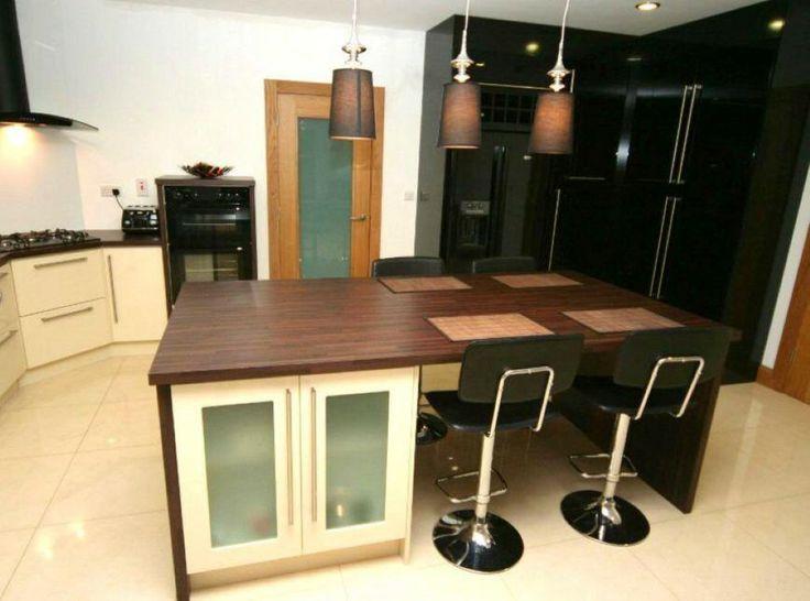 gloss kitchen with walnuts tops http://www.pauljameskitchens.com