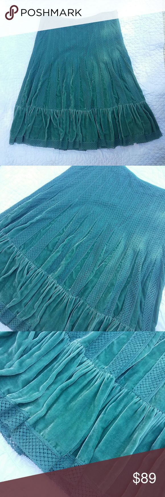 Free People Velvet Lace Pleated Skirt Teal This gorgeous skirt is in excellent condition with no signs of wear. No stains, holes, snags or other flaws. Beautiful teal velevet and lace midi lenth with a side hidden zipper. This is a hard to find color and more than beautiful!! Free People Skirts Midi