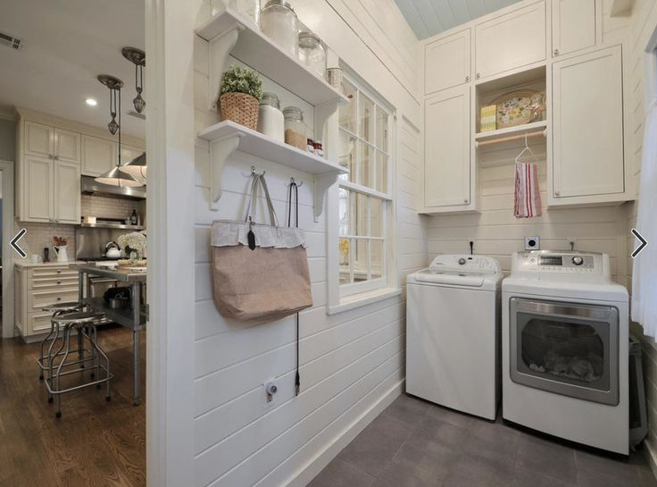 Love the style of this tiny laundry room