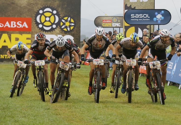 Former Cape Epic winner, Switzerland's Christoph Sauser (C), sprints with other riders for second place during Stage 1 of the annual ABSA Cape Epic mountain bike stage race, Cape Town, South Africa, March 24, 2014. The multi day stage race is know as the 'Tour de France' of mountain biking and sees 1200 riders riding 720 kilometers in seven days. The race includes the worlds leading professional racers along with amateur cyclists.