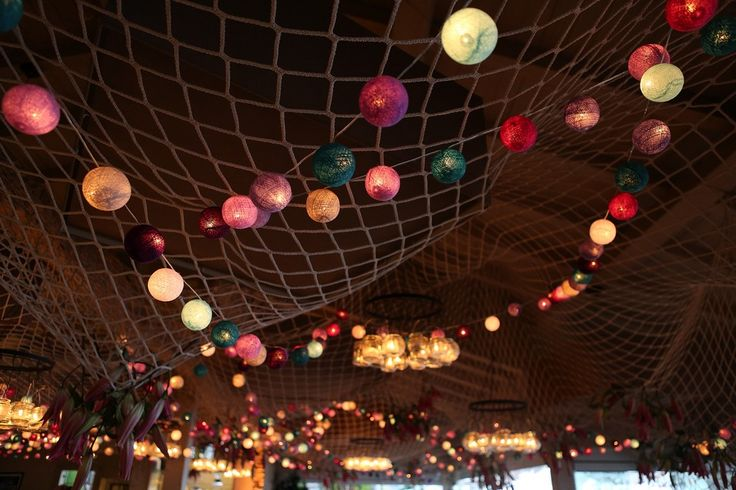 Ceiling decoration with fishing net and coloured light balls