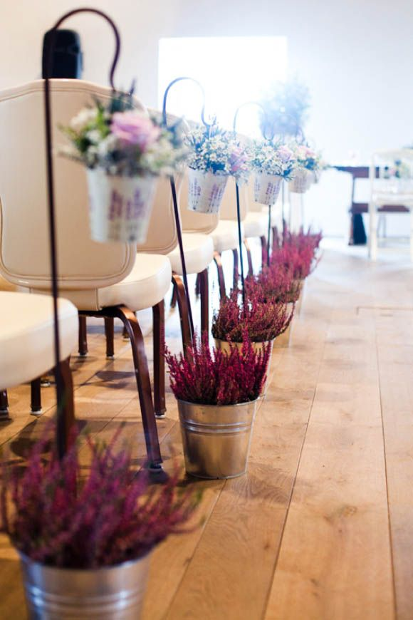 lavender - would want growing still - for aisle - use for table decor afterwards - guests can take home at end