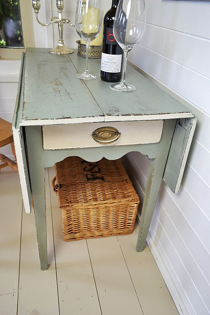 We adore this Pembroke table which oozes rustic charm.  It's practical too ... with extending leaves and a tidy drawer at one end, you can transform a dinner for two into a dinner for the family, in no time.  Painted in 'Rococo' (a mixture of Duck Egg Blue and Old White), with edging detail and drawer in white.  Petit space is no problem for this pretty Pembroke!