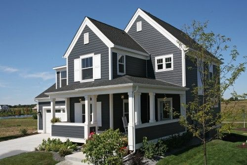 I love with dark-colored houses with white trim- like this!