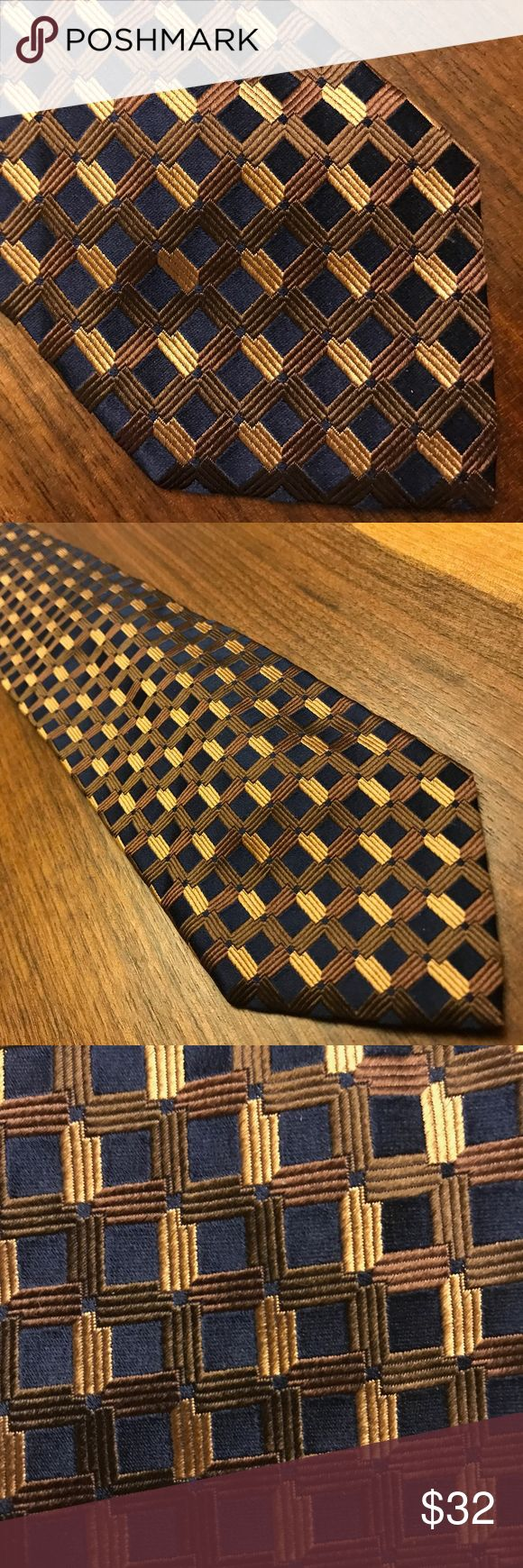 Hugo Boss Geometric Square Tie 🇮🇹 Hugo Boss AG, often styled as BOSS, is a German luxury fashion house. It was founded in 1924 by Hugo Boss and is headquartered in Metzingen, Germany. This tie features a geometric square pattern and is made in Italy. Excellent condition - no tears, rips or stains.  Tie at widest part 3 3/5 inches W Hugo Boss Accessories Ties