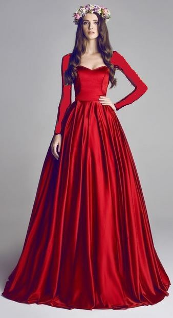 I love this color. I'm getting a little obsessed with the idea of a red dress with gold accents.