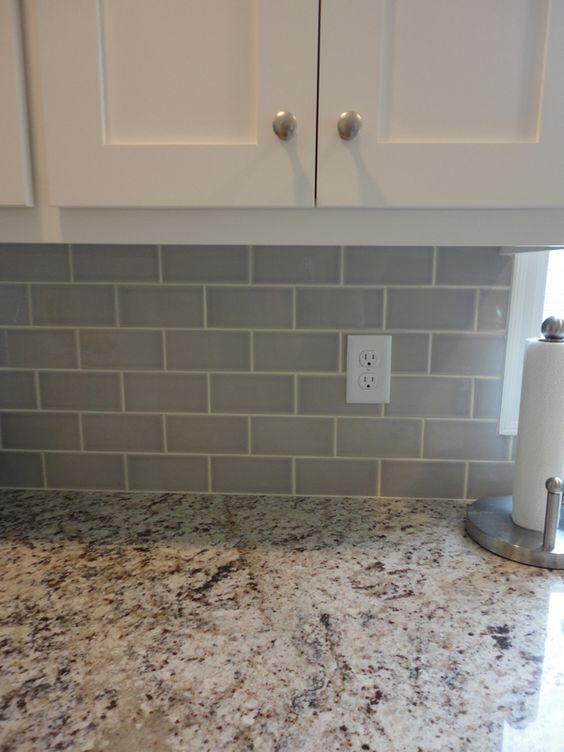 Giallo Ornamental Granite for Warm & Elegant Kitchen Design | Aqua Kitchen & Bath Design Center / #GialloOrnamental with #GraySubwayTiles creates a nice, gentle and modern combination.