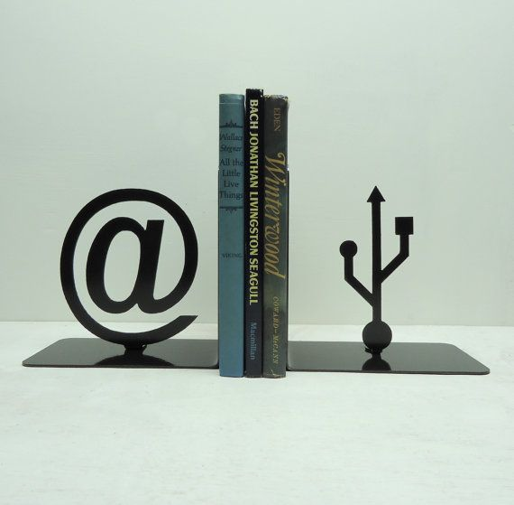 "Since my initials are ""AT"", I might be in want of new bookends. At Symbol and USB Symbol Bookends by KnobCreekMetalArts, $49.99"